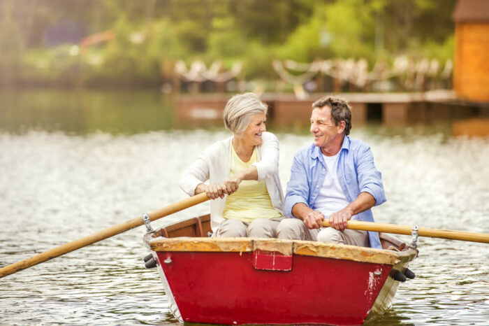 Happy older couple in rowboat