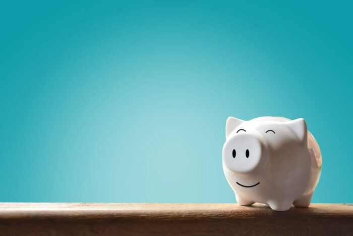 white piggy bank with blue background