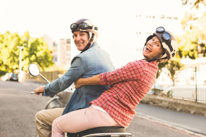 Couple on moped without glasses